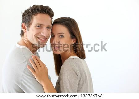 Smiling couple on white background - stock photo