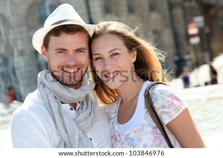 Smiling couple visiting French city in summertime - stock photo