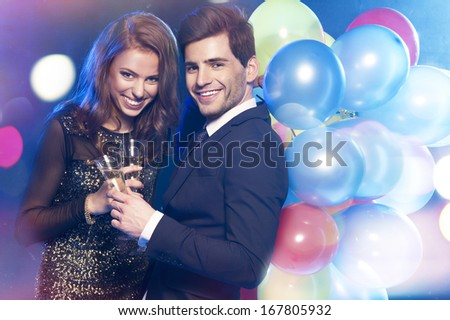 Smiling couple with glasses of champagne  - stock photo