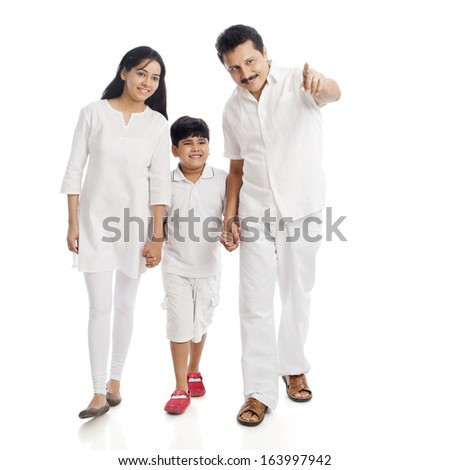 Smiling couple with their son - stock photo