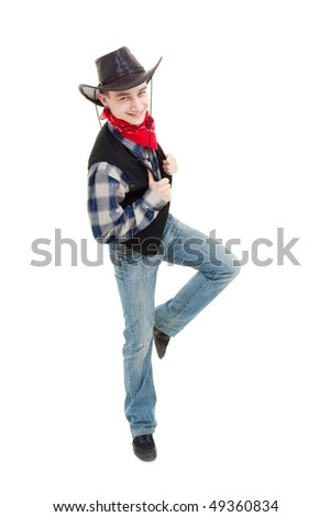 Smiling cowboy dancing on a white background - stock photo