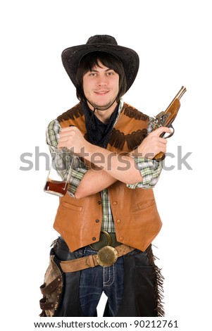 Smiling cowboy with a bottle and gun in hands - stock photo