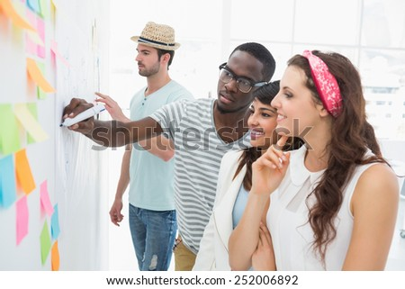 Smiling coworkers speaking and brainstorming in the office - stock photo