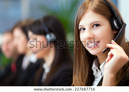 Smiling customer representative at work - stock photo