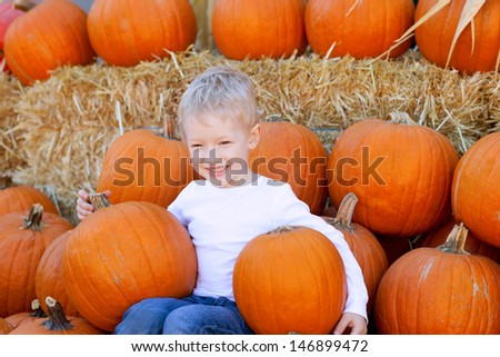smiling cute boy at the pumpkin patch