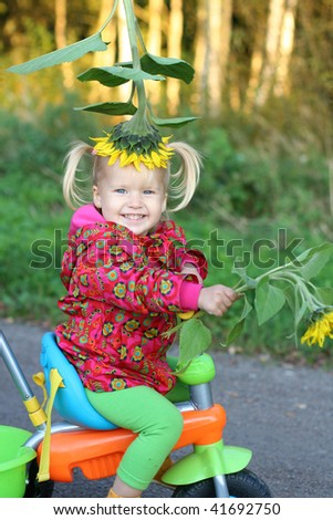 Smiling cute girl on bike - stock photo