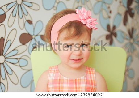 smiling cute girl with rose headband  - stock photo