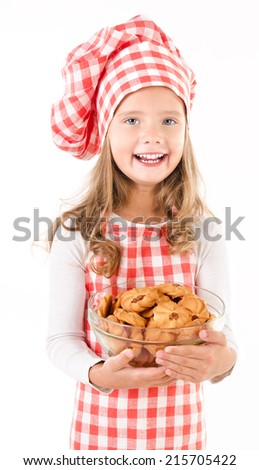 Smiling cute little girl in chef hat holding bowl with cookies isolated on a white - stock photo