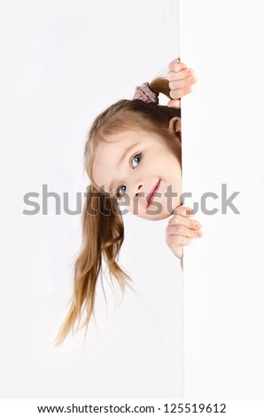 Smiling cute little girl isolated on white