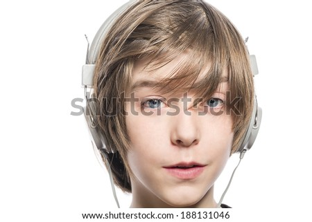 smiling cute teenager boy with headphones, isolated on white. - stock photo