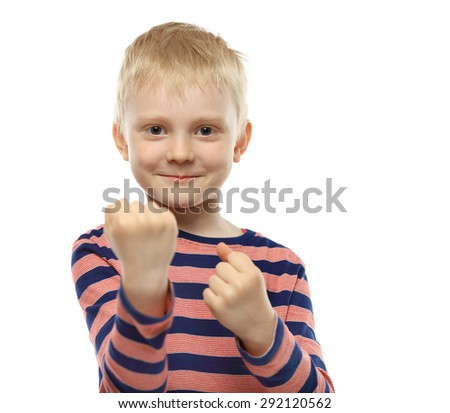 Smiling cute young boy showing his fists, isolated on white