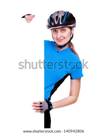 smiling cyclist girl in blue jersey holding the vertical blank board on white background - stock photo