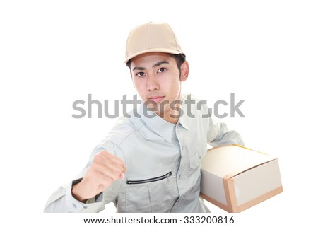 Smiling delivery man - stock photo