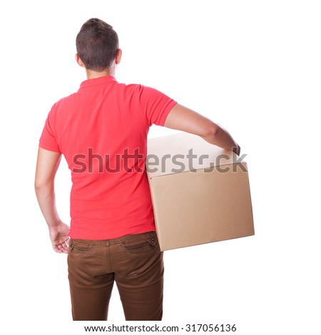 Smiling delivery man is holding a paper box. Back view. Isolated on white - stock photo