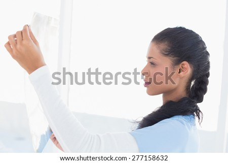 Smiling doctor analyzing xray in medical office