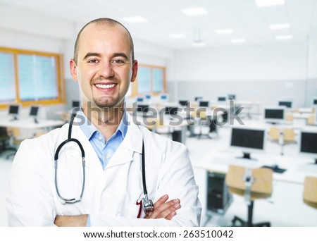 smiling doctor and classroom background - stock photo