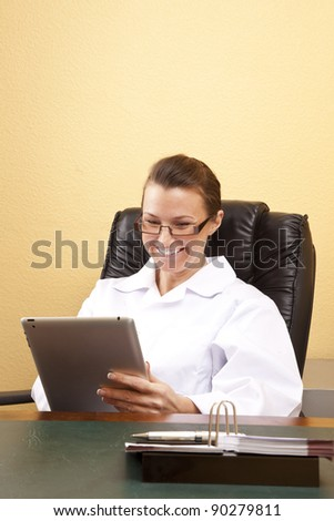 Smiling doctor behind the desk - stock photo