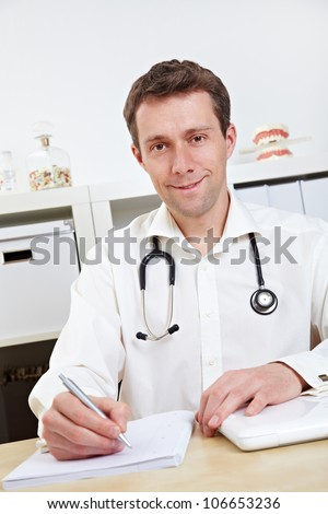 Smiling doctor listening to a patient during consultation - stock photo