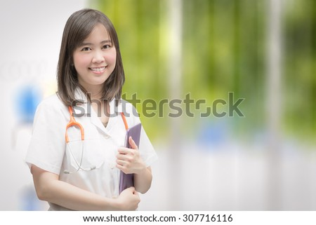 smiling doctor wearing gown - stock photo
