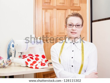 smiling dressmaker in a workroom