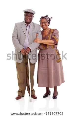 smiling elderly africam couple standing on white background - stock photo