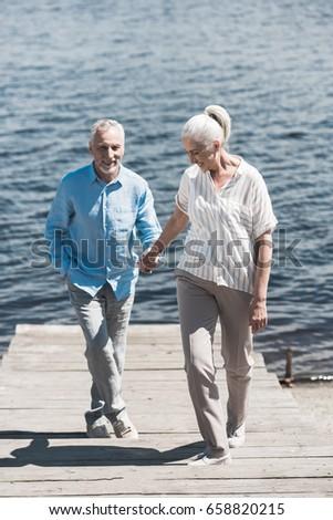 Elderly Holding Hands Walking