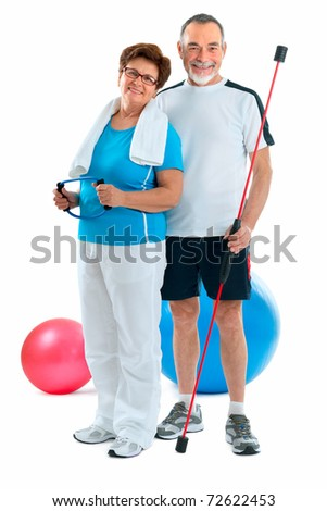 Smiling elderly couple working out in gym. Isolated on white. - stock photo