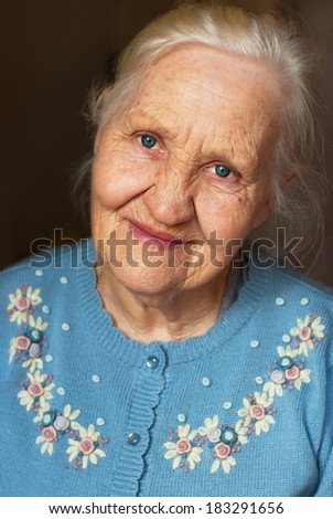 Smiling elderly woman portrait - stock photo