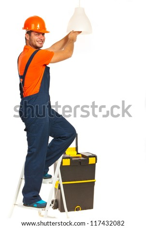 Smiling electrician working change a bulb isolated on white background - stock photo