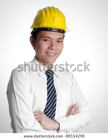 Smiling Engineer Crossing Arms - stock photo