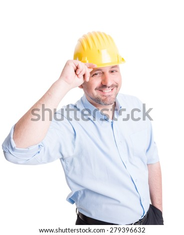 Smiling engineer or architect greeting gesture by touching or lifting his yellow helmet - stock photo