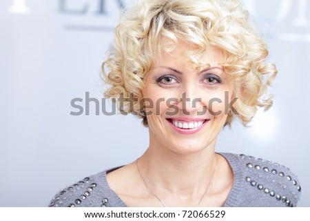 Smiling face of a middle-aged blonde pretty woman - stock photo