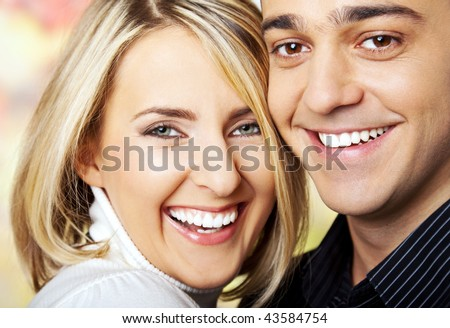 smiling faces of a happy couple cheek by cheek
