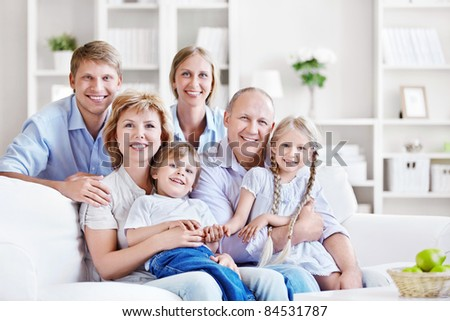 Smiling family at home - stock photo