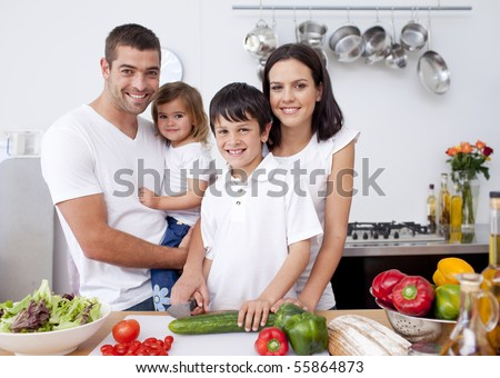 Smiling family cooking together in the kitchen - stock photo