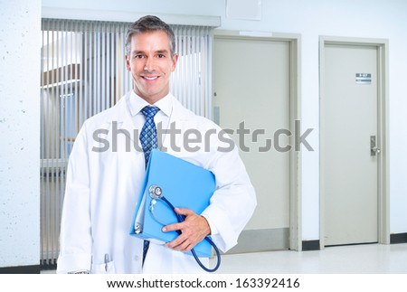 Smiling family doctor with stethoscope. Health care. - stock photo