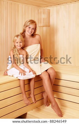 Smiling family in the sauna - stock photo