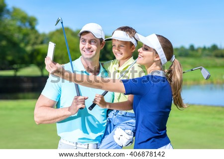 Smiling family making selfie outdoors