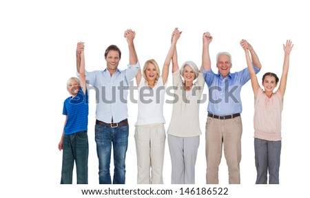 Smiling family raising their arms against white background - stock photo