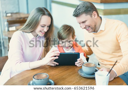 Smiling family with a child