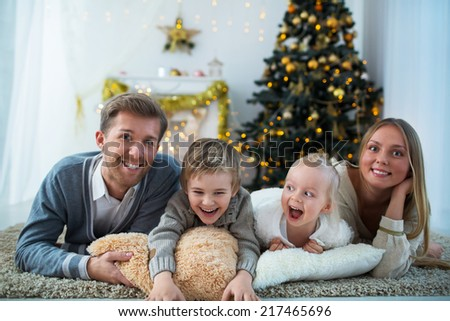 Smiling family with children at home - stock photo