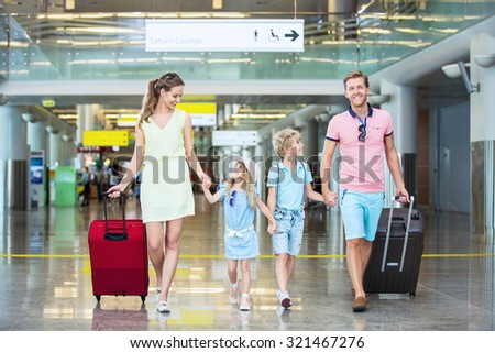 Smiling family with children at the airport - stock photo