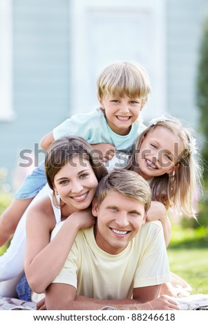 Smiling family with children on the lawn