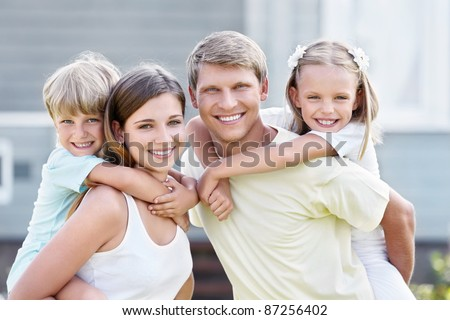 Smiling family with children outdoors - stock photo