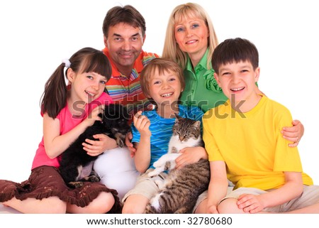 Smiling family with pets - stock photo