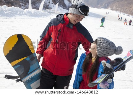 Smiling Father and Daughter in Ski Resort
