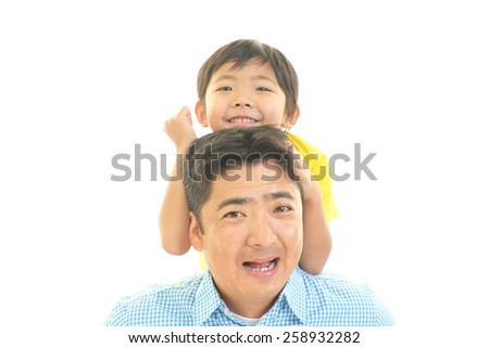 Smiling father and son - stock photo