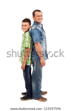 Smiling father and son standing back to back, isolated on white background - stock photo