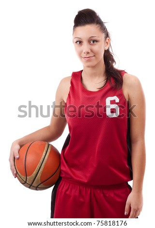 Smiling female basketball player holding ball, isolated on white background - stock photo