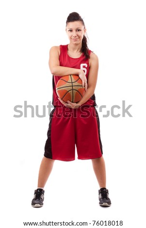 Smiling female basketball player with ball, isolated on white background - stock photo